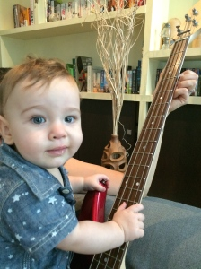 Look at that, without even asking he's all over my bass. I bet he's got dribble and mashed baby rice in the pots.